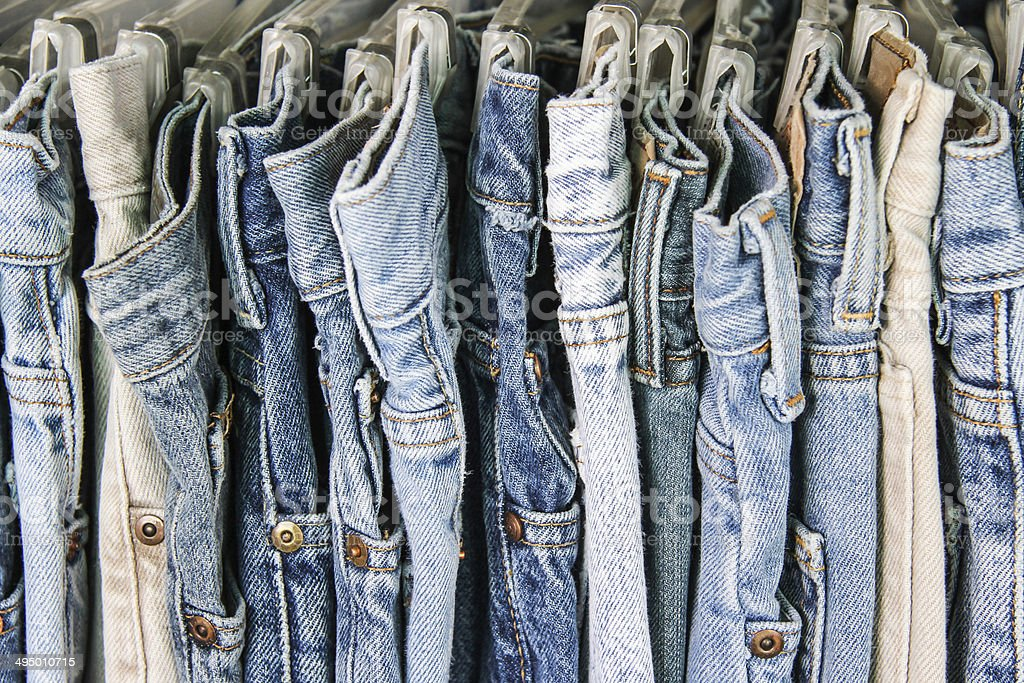 rack of second hand jeans stock photo