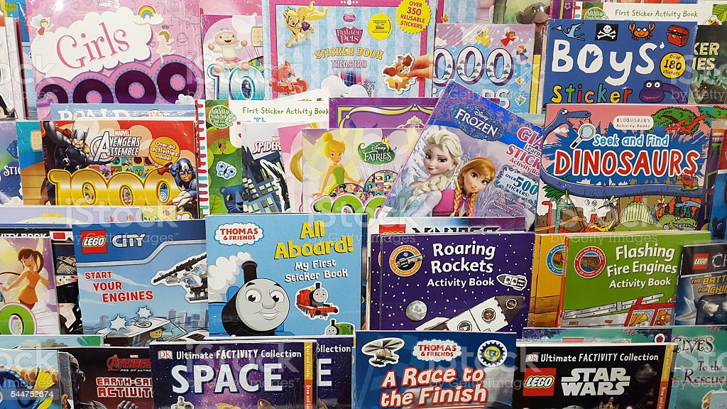 Rack of varied, colorful children's books stock photo