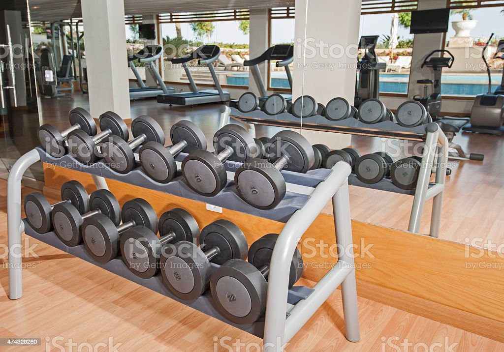 Rack of weights in a gym stock photo