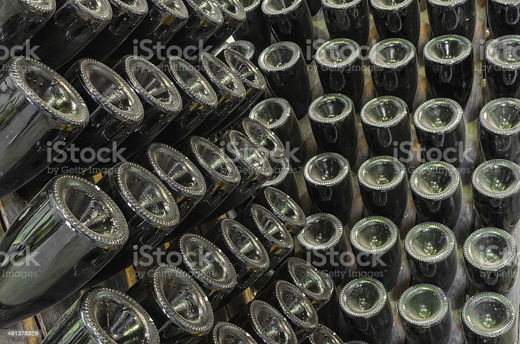 Rack stand with dusty bottles stock photo