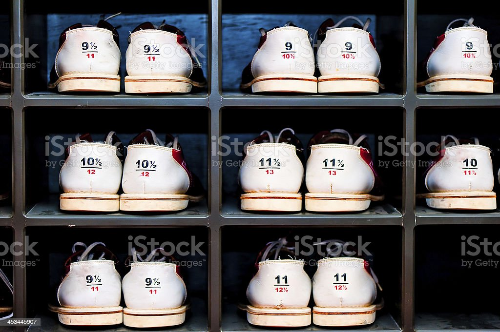 rack with shoes for bowling in different sizes royalty-free stock photo