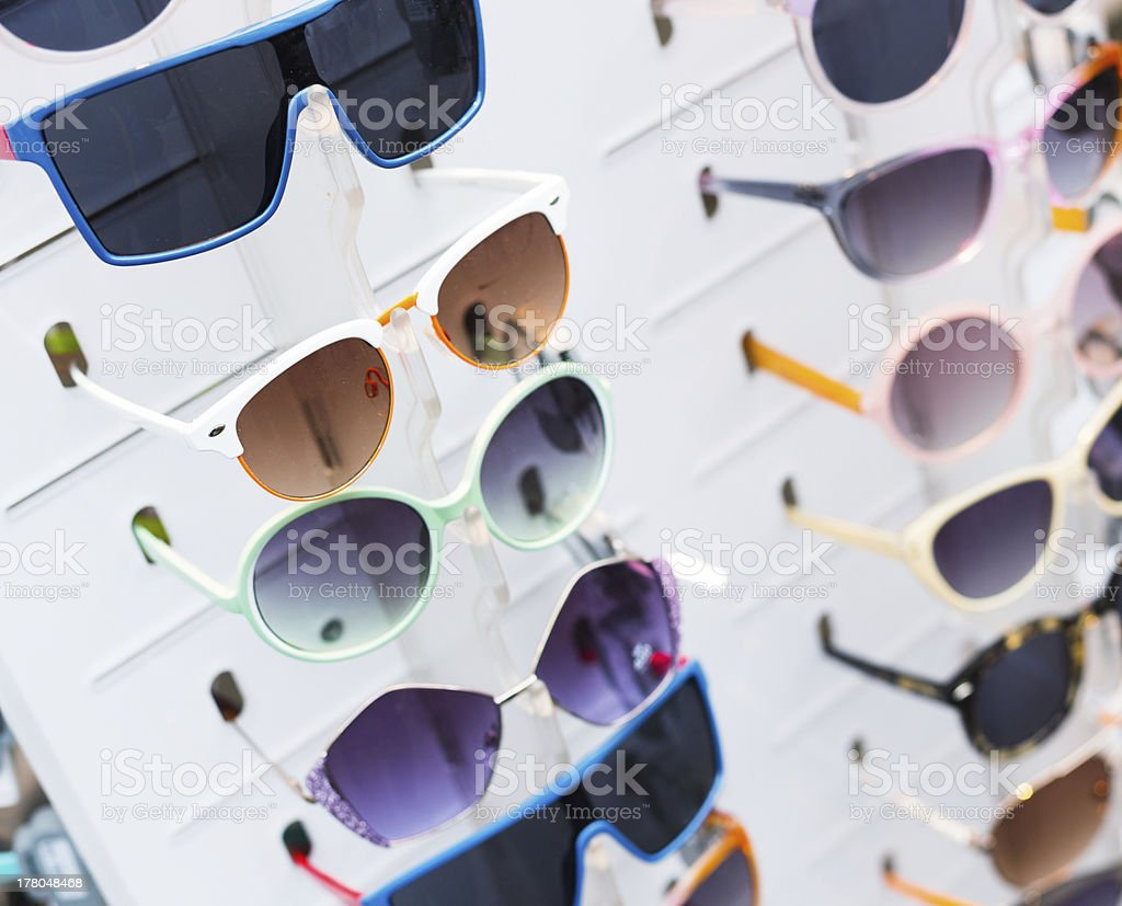 Rack with sunglasses stock photo