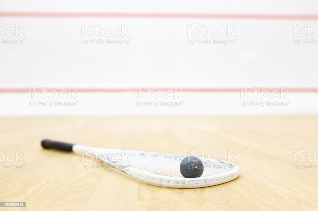 racket and ball for squash game stock photo