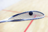 racket and ball for squash