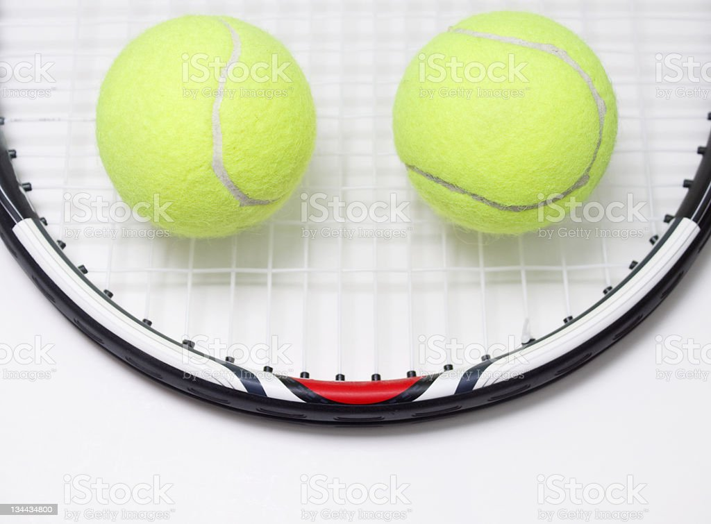 Racket and ball, smiling royalty-free stock photo