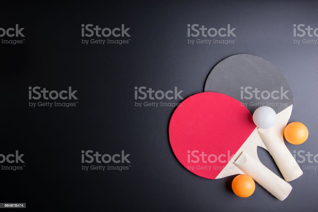 Racket table tennis with ping pong ball on black background.Sport concept, Copy space image for your text. stock photo