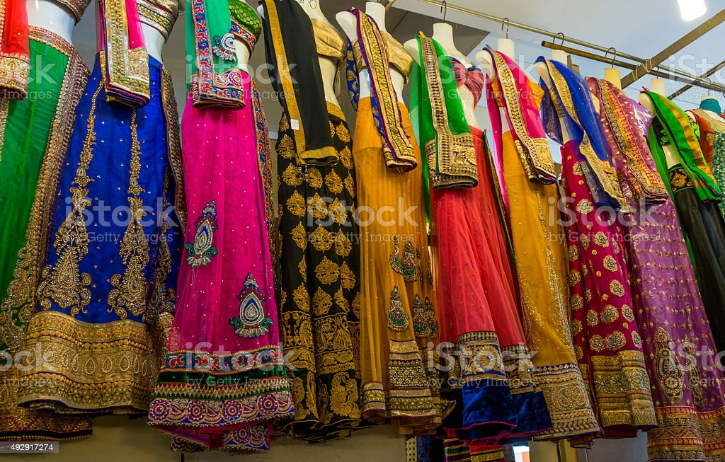 Racks of colourful sari's in a Indian market stock photo