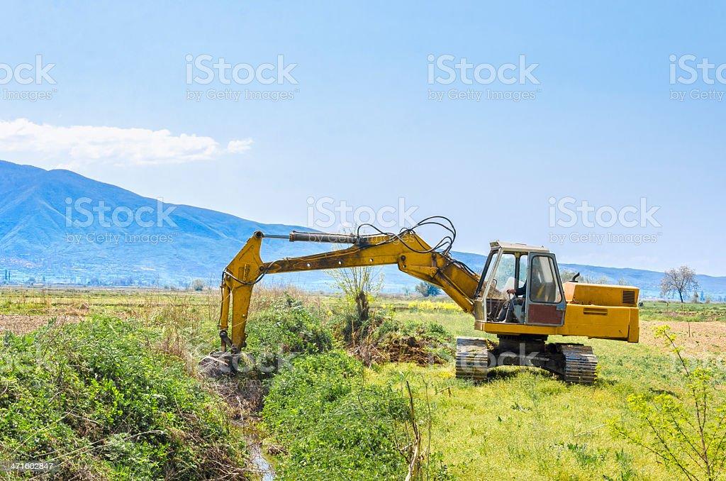 rack-type loader excavator machine digging stock photo