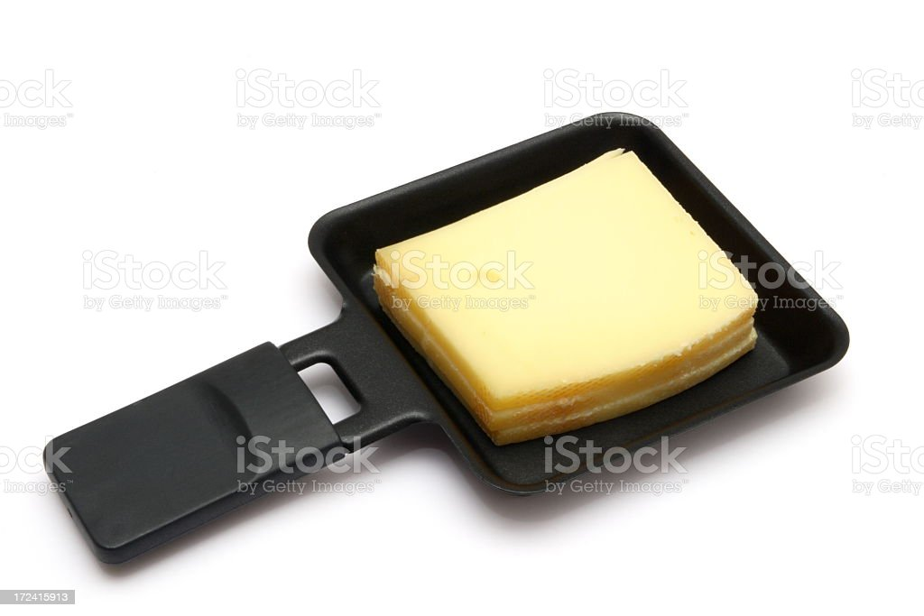 Raclette cheese in a square pan in a white background stock photo