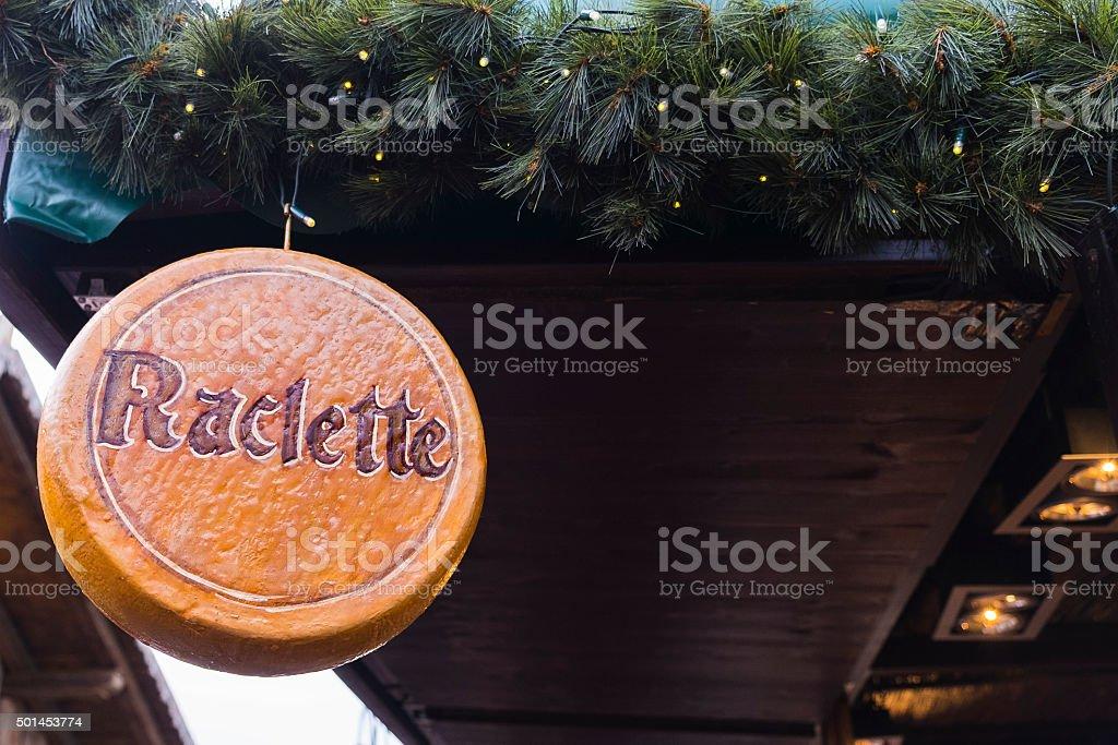 Raclette cheese-wheel. stock photo
