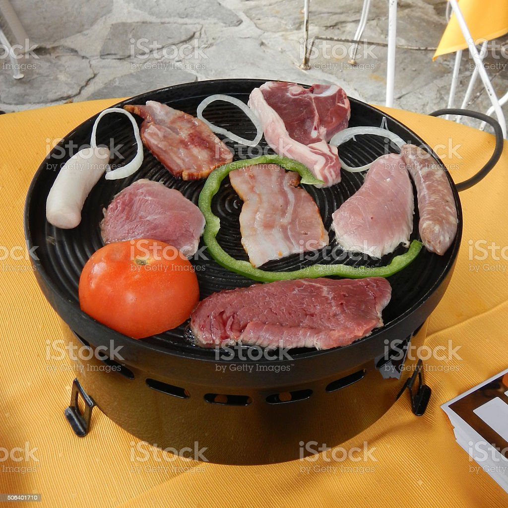 Raclette with meat and vegetables stock photo