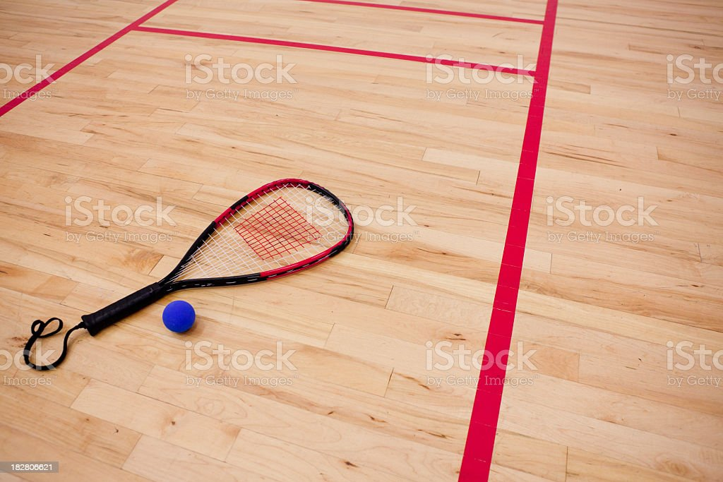 Racquet equipment on court royalty-free stock photo