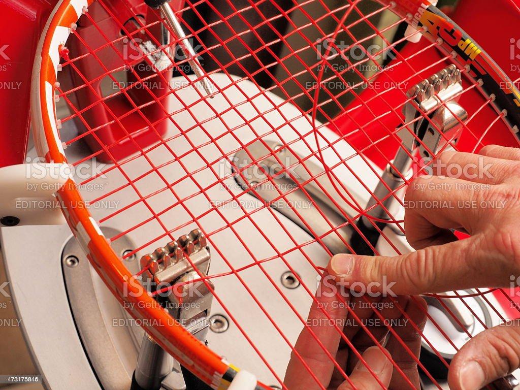 Racquet stringer weaving Tennis cross strings stock photo