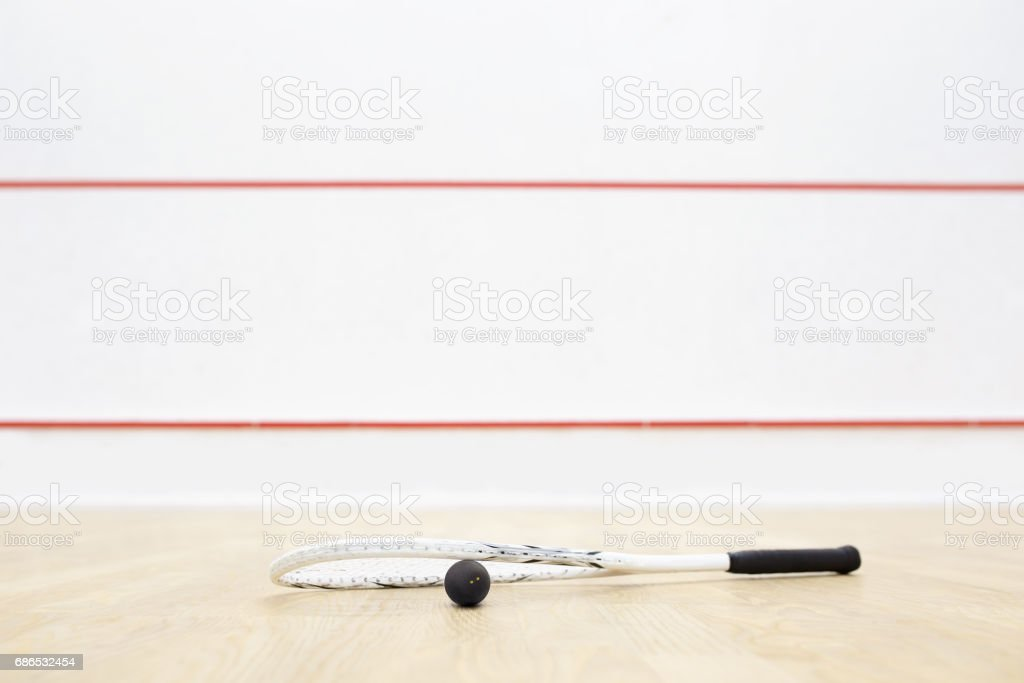 racquetball equipment and wall with red lines stock photo