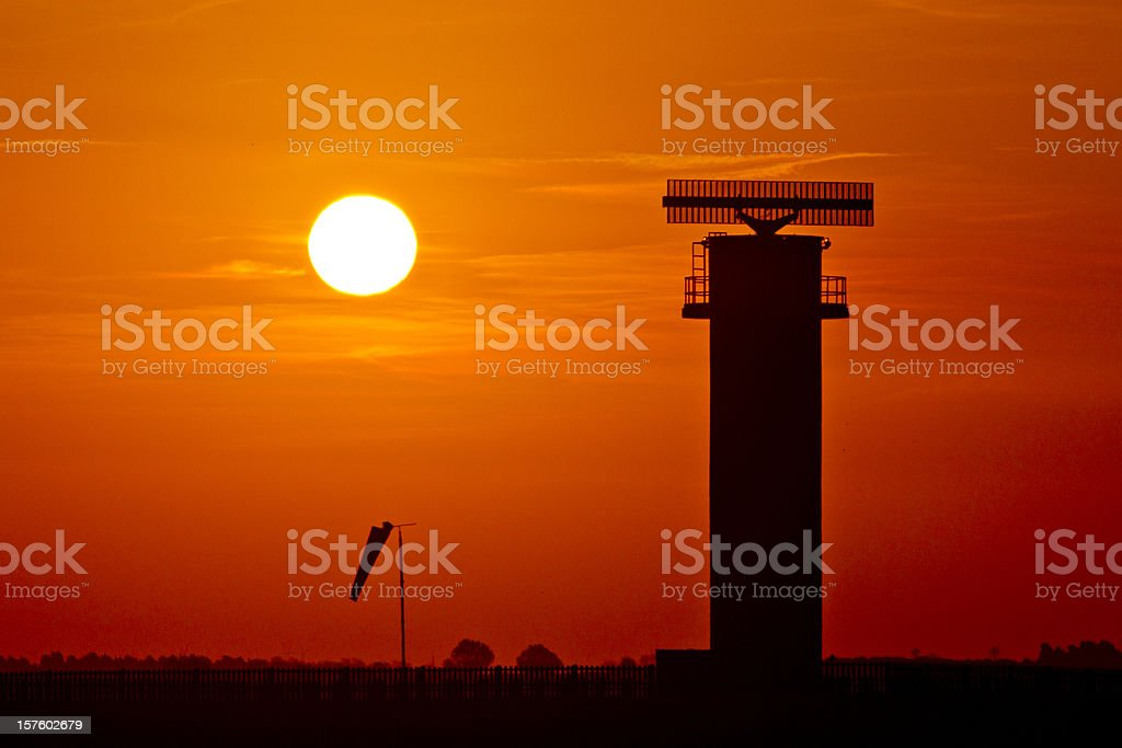 Radar and windsock at sunset. royalty-free stock photo