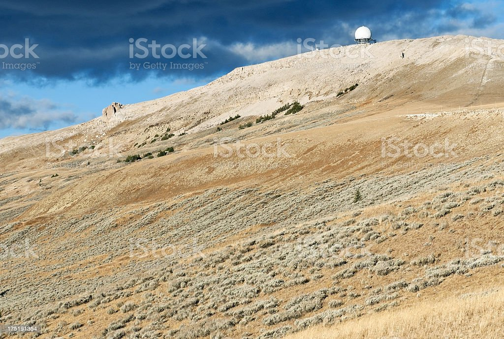 Radar dome on mountain summit in Wyoming royalty-free stock photo