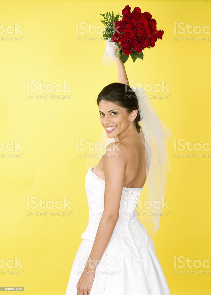 Radiant Bride Holding Roses High royalty-free stock photo