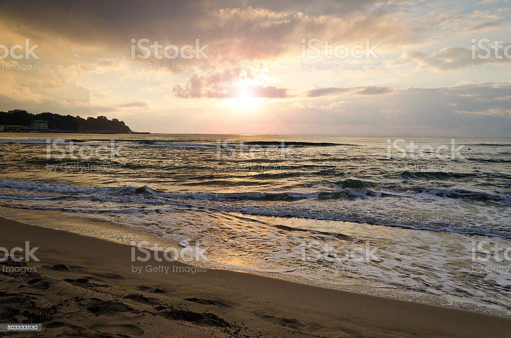 Radiant sea beach sunrise in Kiten, Bulgaria stock photo