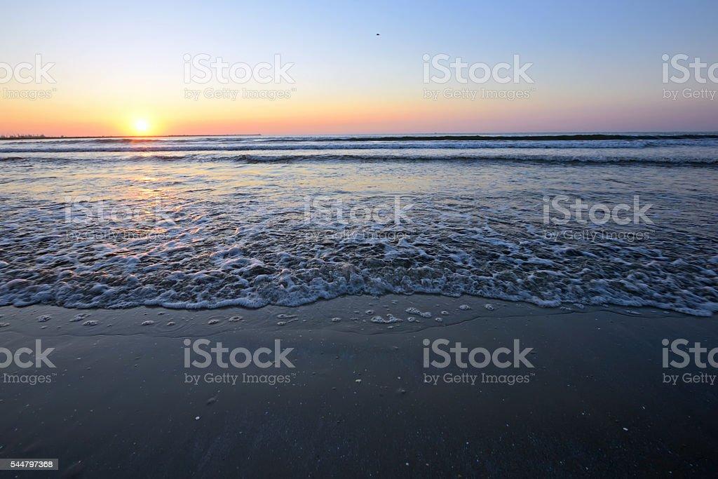 Radiant sea beach sunrise stock photo