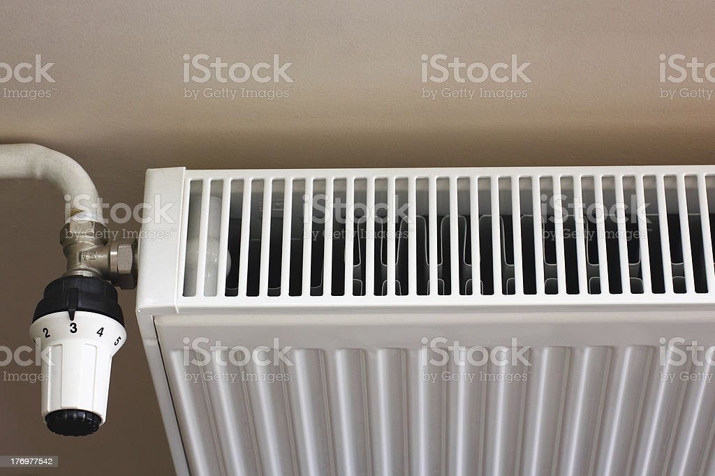Radiator and thermostat valve royalty-free stock photo