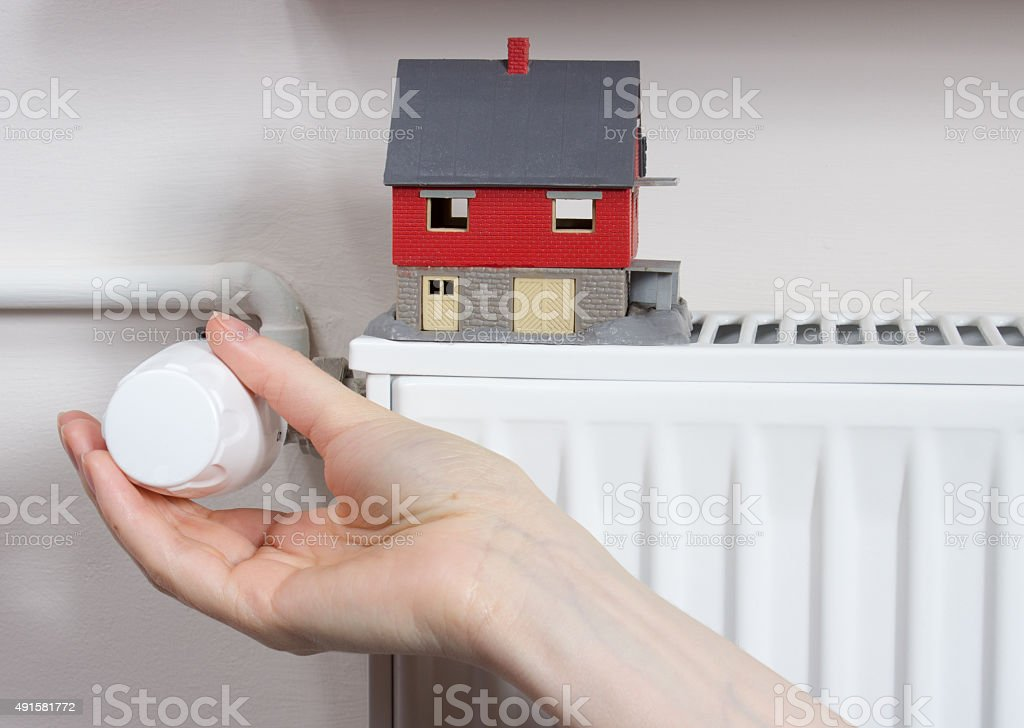 Radiator thermostat.  Concept of saving thermal energy. stock photo