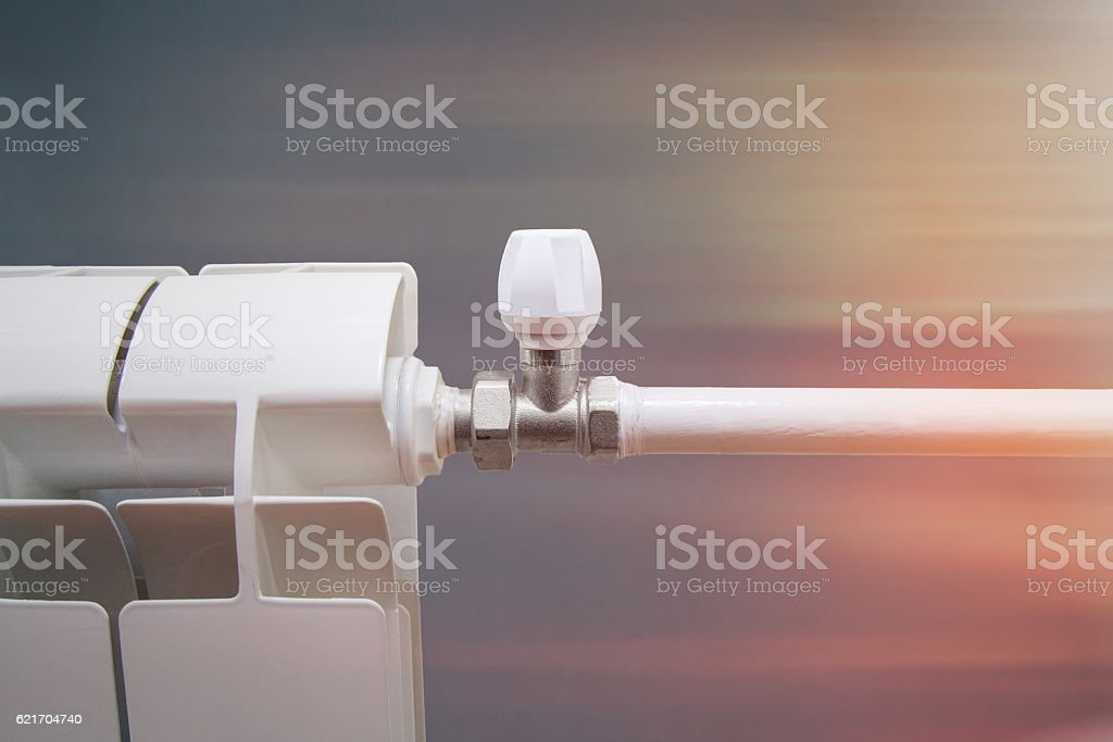 radiator with a valve for regulating the heat stock photo