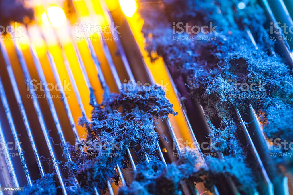 CPU radiator with dust illuminated by light stock photo