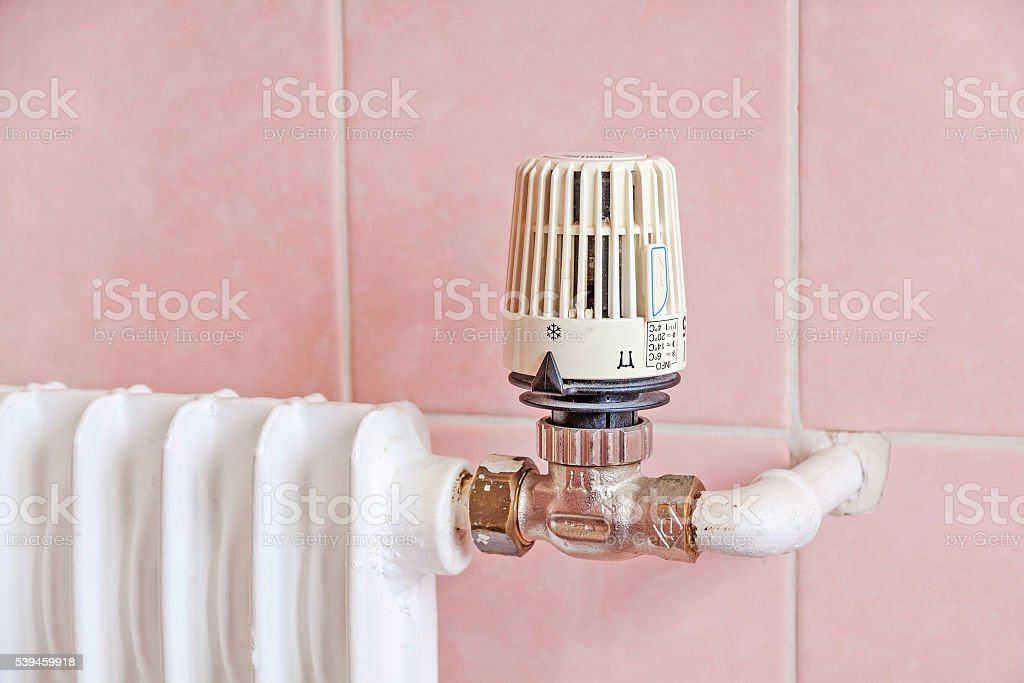 radiator with thermostat stock photo