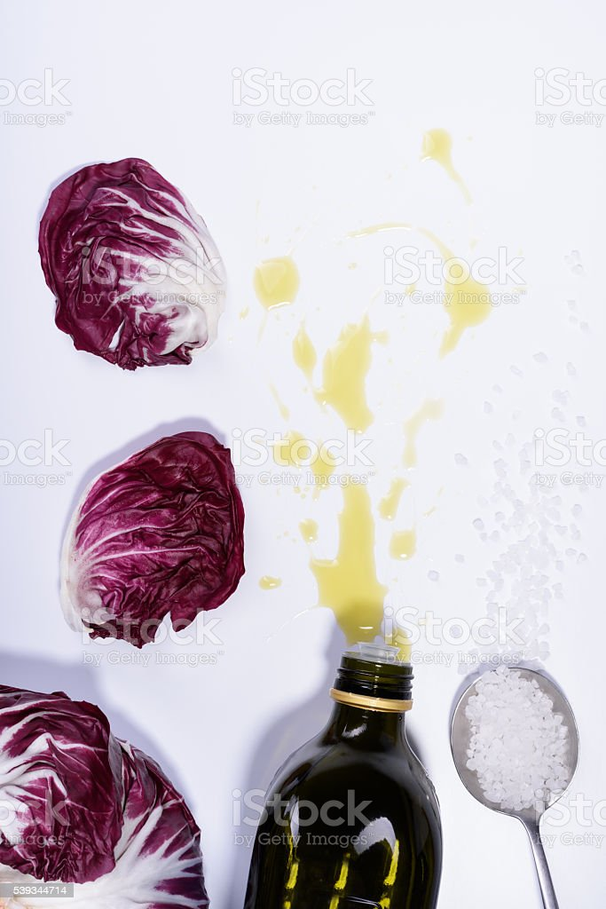 Radicchio red salad leaves with olive oil and salt. stock photo