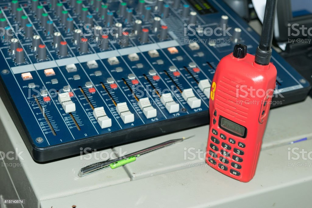 Radio communications Orange is placed on the sound control. stock photo
