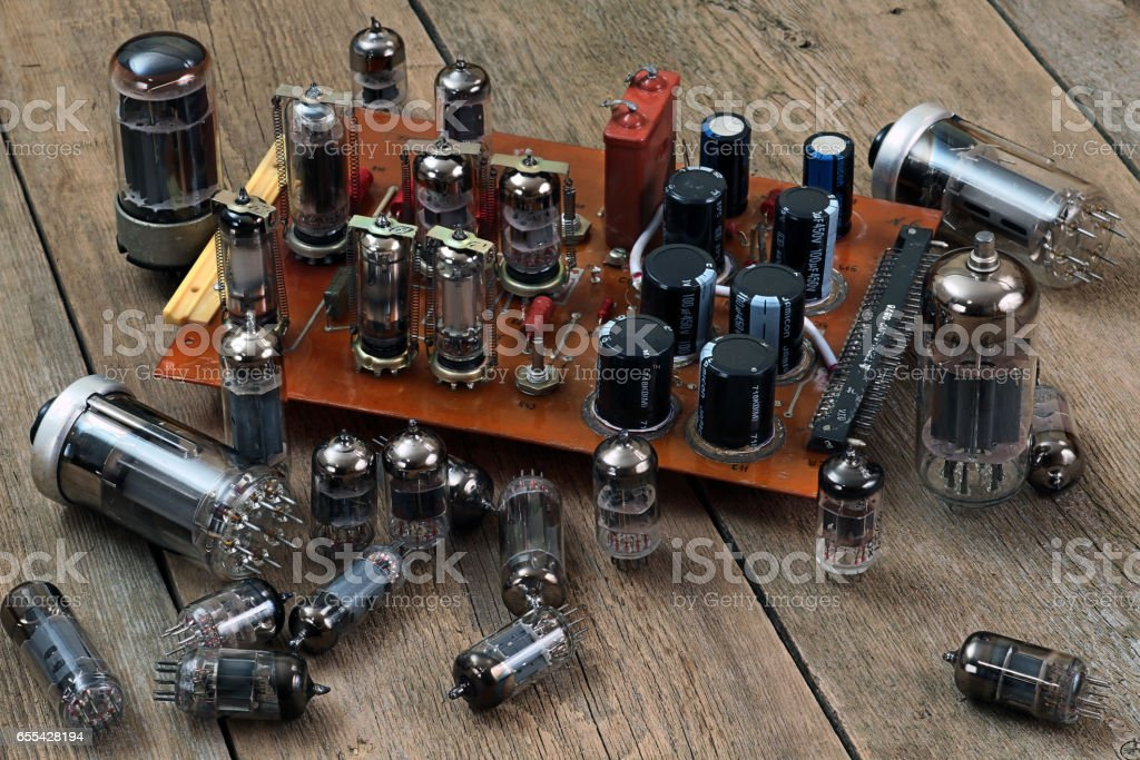radio lamps and transistors on a wooden table stock photo