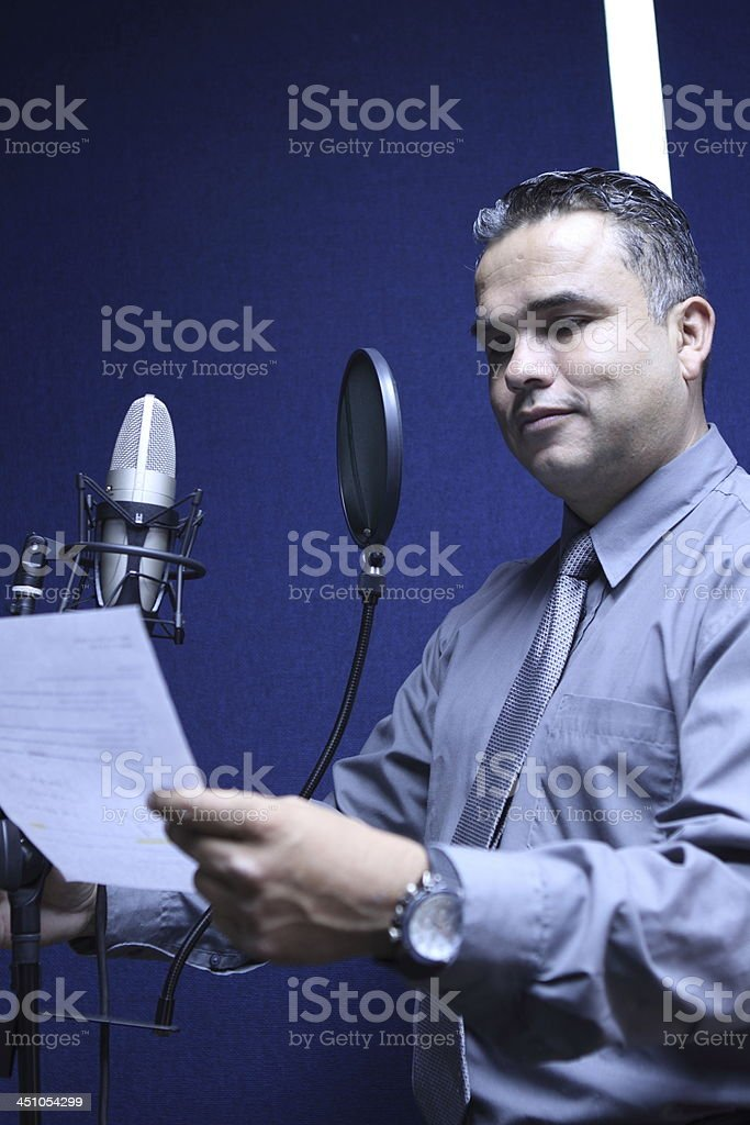 Radio Man Making Comments on Mic stock photo