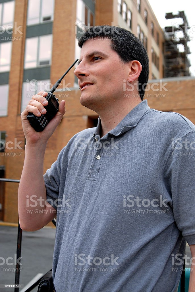 Radio Operator In Front Of Building stock photo