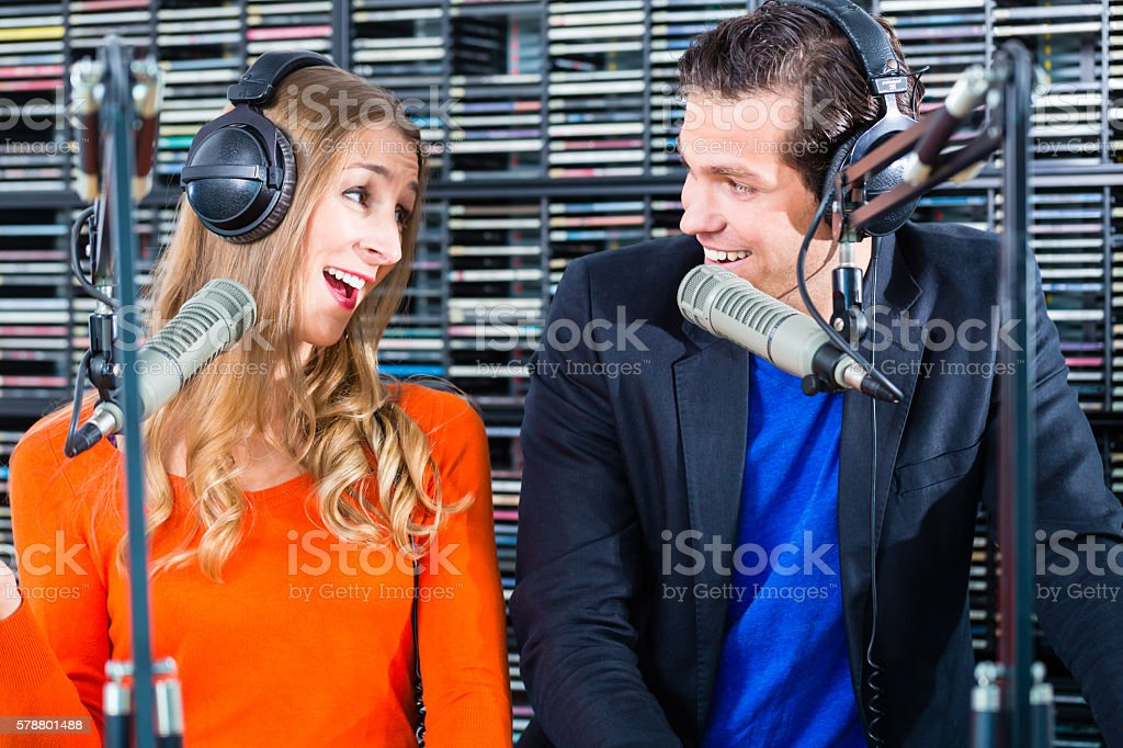 radio presenters in radio station on air stock photo