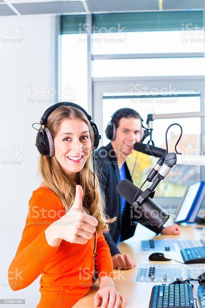radio presenters in radio station on air stock photo