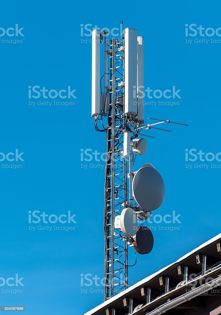 GSM radio satellite antenna on a mountain house stock photo