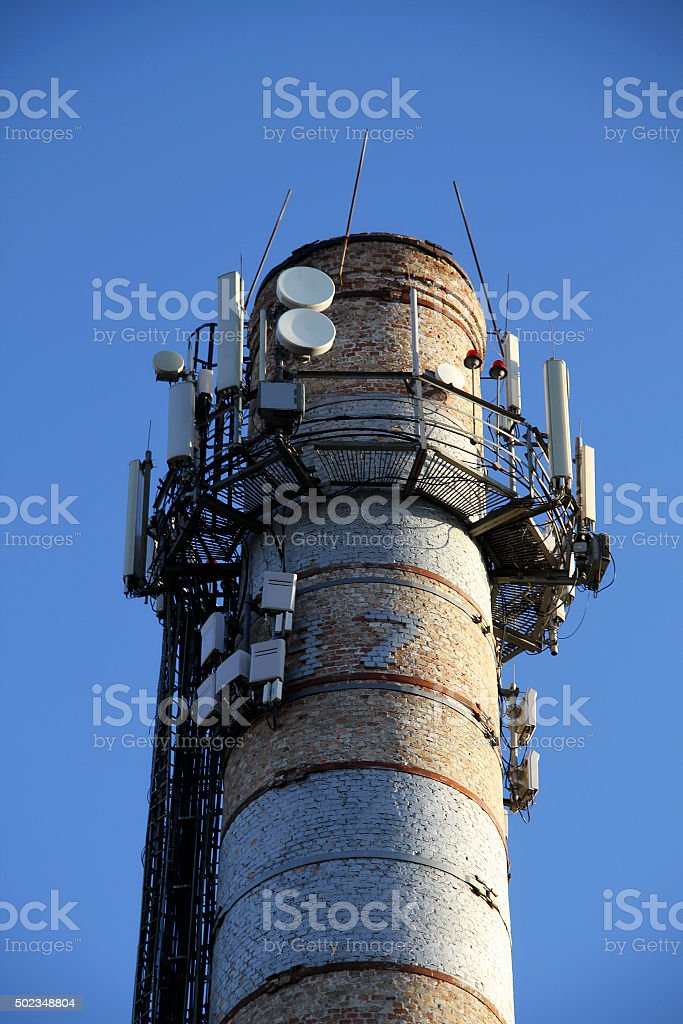 Radio signal location system on the top of old smokestack stock photo