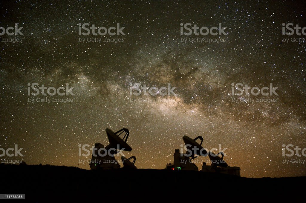 Radio telescope silhouettes observing starry skies royalty-free stock photo