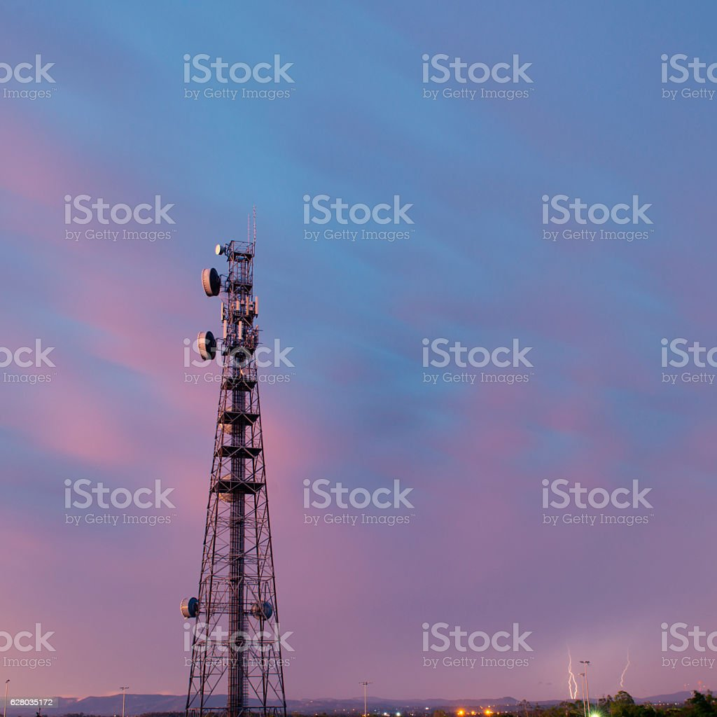 Radio tower in Queensland during a lightning storm. stock photo