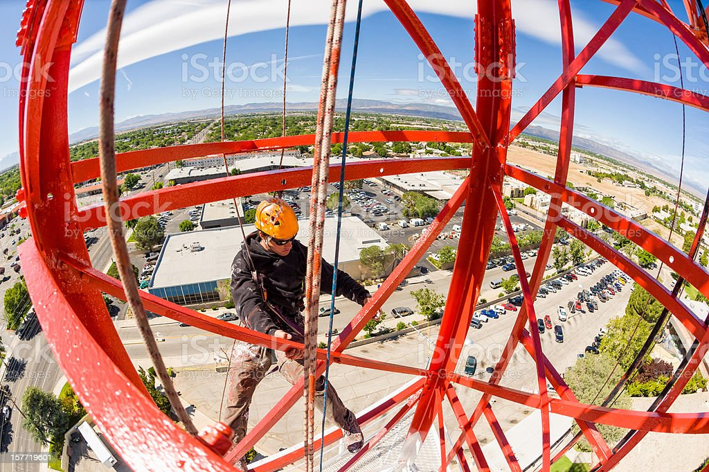 Radio Tower Worker Painting From High Up royalty-free stock photo