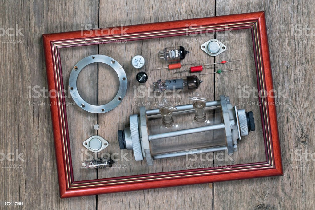 Radio tubes and electronic components in a wooden frame stock photo