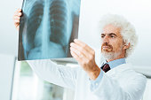 Radiologist checking patient's x-ray images
