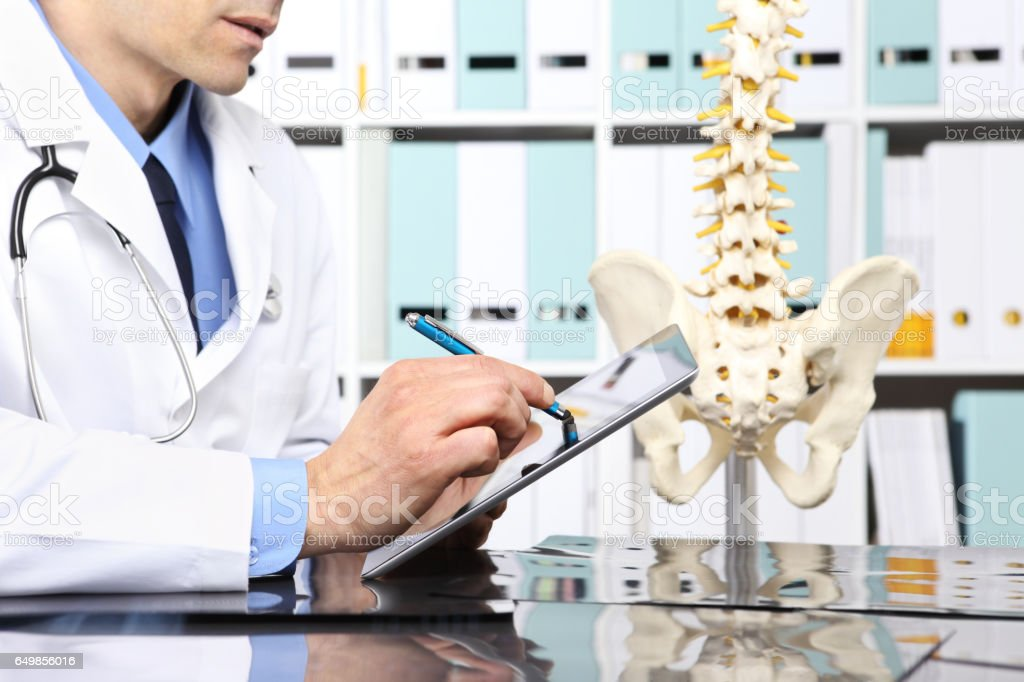 Radiologist doctor with digital tablet checking xray, healthcare, medical and radiology concept stock photo