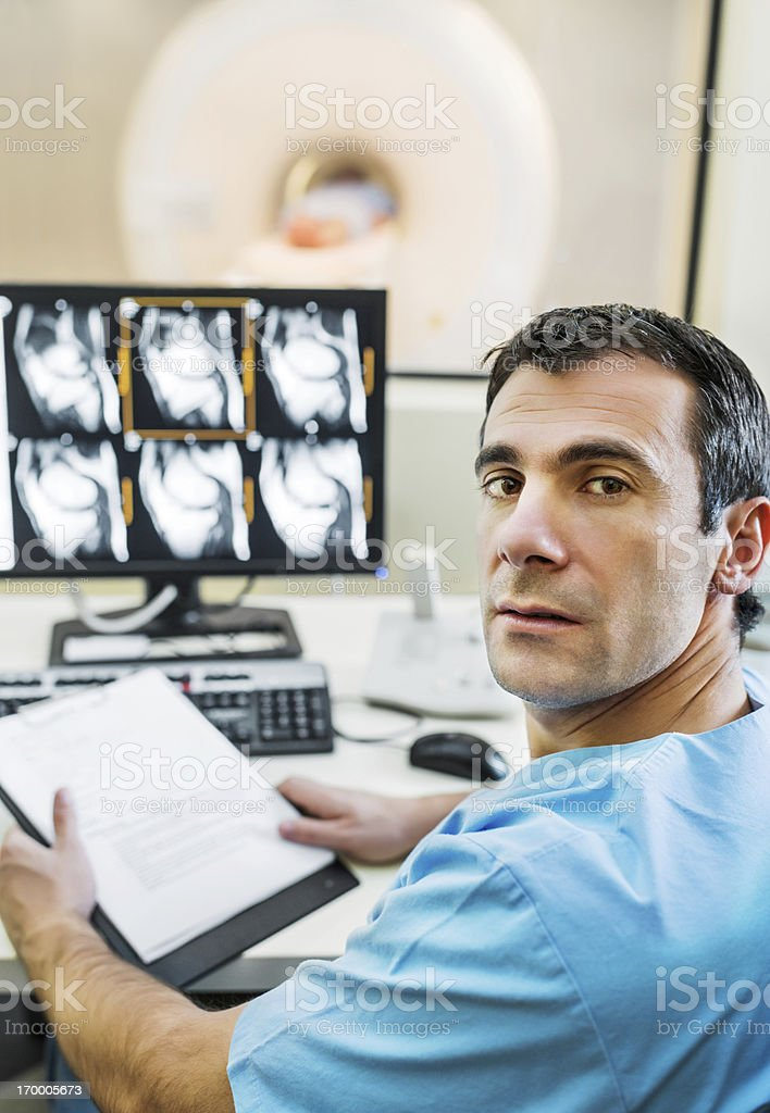 Radiologist examining MRI scans. royalty-free stock photo