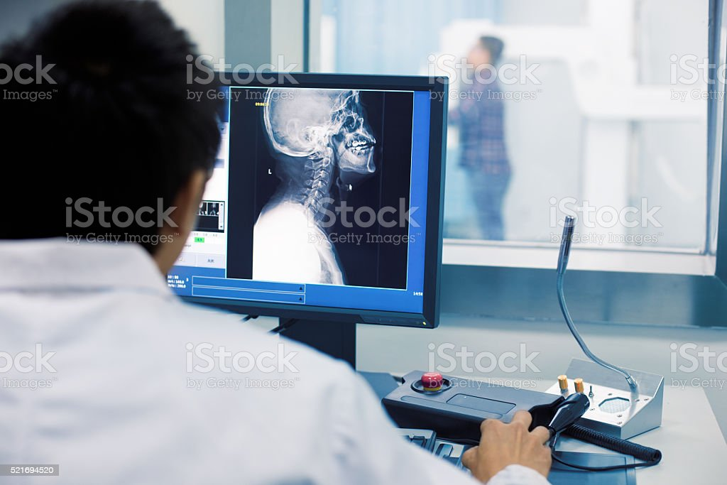 Radiologist examining MRI scans stock photo