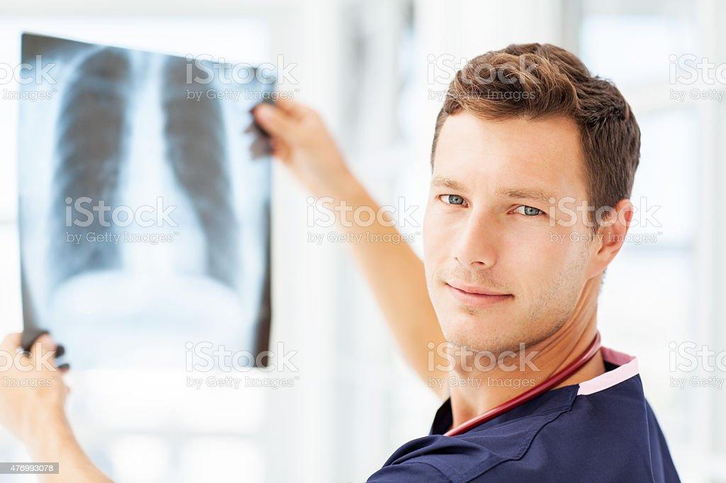 Radiologist Examining X-Ray In Hospital stock photo