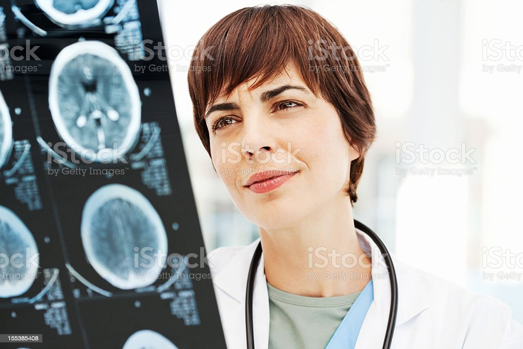 Radiologist Reviewing MRI Scan Of Brain stock photo