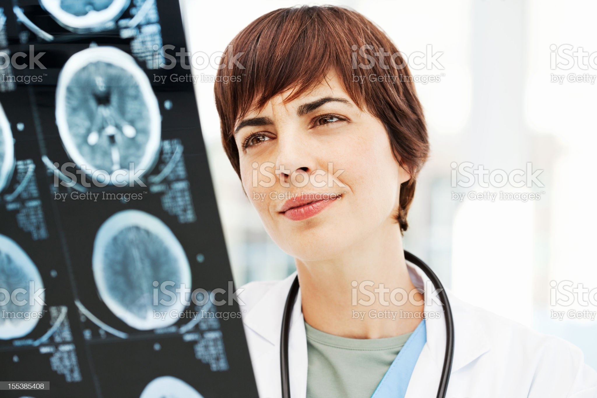 Radiologist Reviewing MRI Scan Of Brain royalty-free stock photo