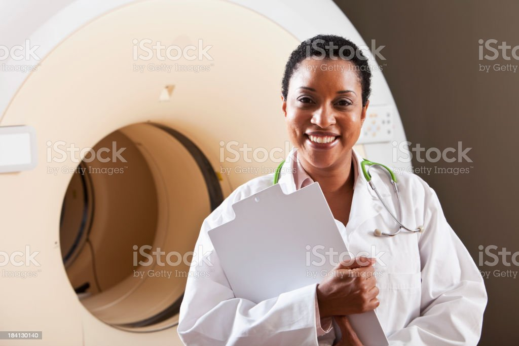 Radiologist with integrated PET-CT scanner stock photo