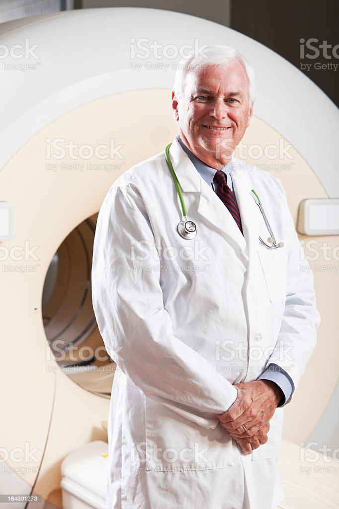 Radiologist with integrated PET-CT scanner royalty-free stock photo